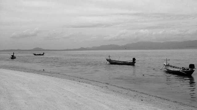 Fishing boats in Thailand near the shore.
