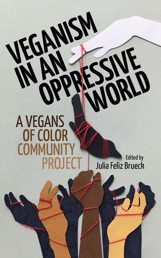 "Picture of a hand with a piece of string on one finger connected to a dangling shape of an animal with a series of raised fists below. Text on the image says ""Veganism In An Oppressive World. A Vegans Of Color Community Project. Edited by Julia Feliz Brueck."""