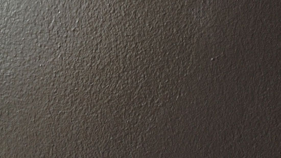 Photo of a grey wall with speckled texture.