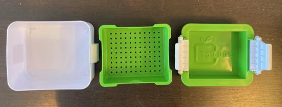 Three pieces of the Tofuture tofu press.